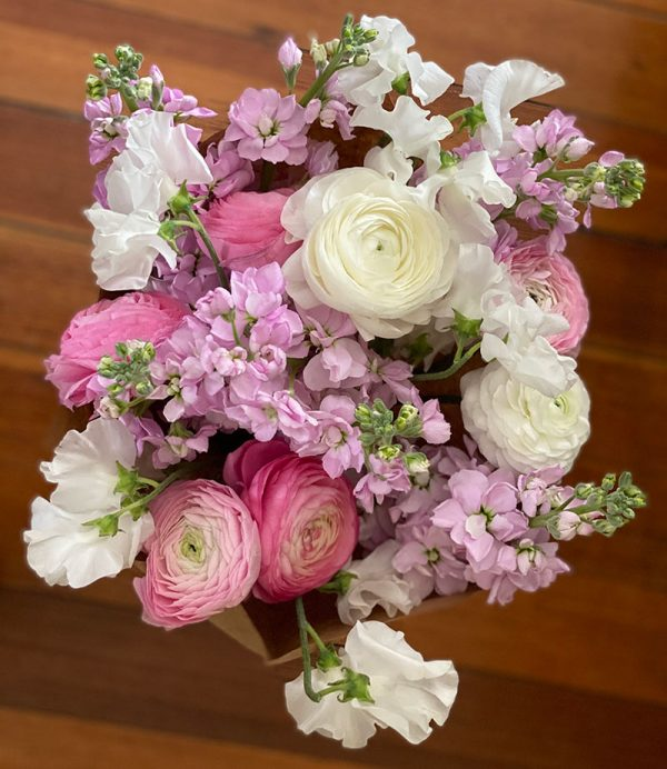 pink and white spring bouquet, farm CSA share flowers, ranunculus, stock and sweet peas
