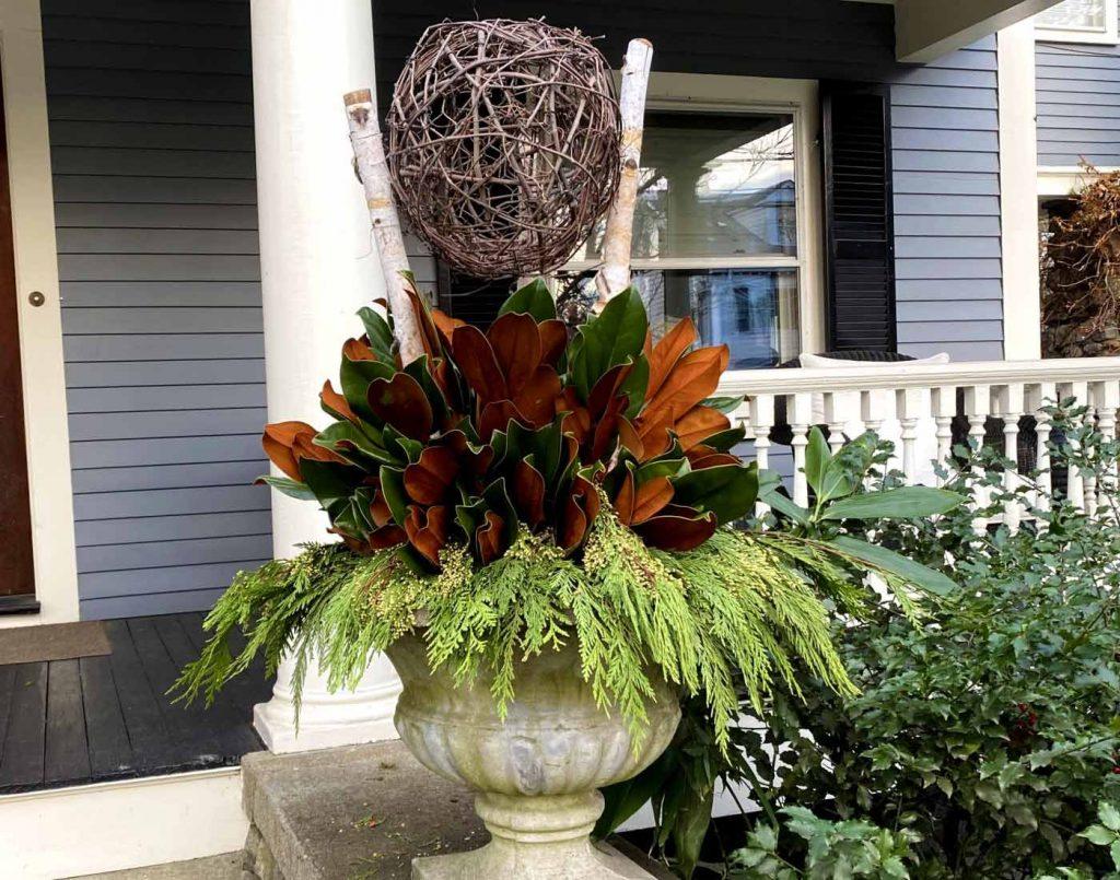custom container garden design, winter planting, floral display exterior